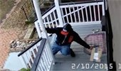 Man stealing package from a front porch