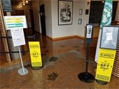 City Hall lobby signage - practice social distancing