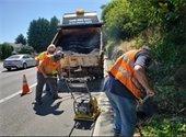 Public works repairing asphalt