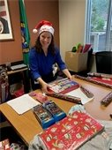 Det. Troxell wrapping a gift
