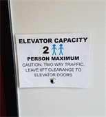 Elevator capacity sign: 2 person maximum