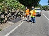 Public Works crew repairing asphalt